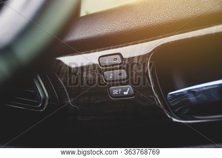 Driver Seat Memory Button With Two Memory System For Quick Tilt Adjustment Inside A Luxury Car.
