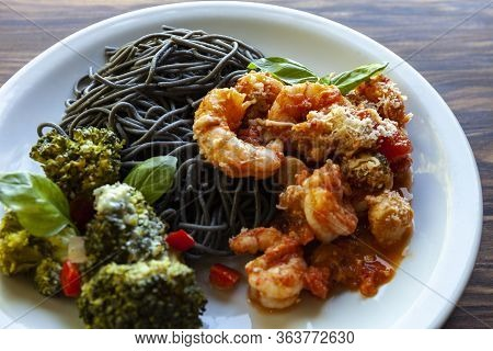 Black Spaghetti With Shrimp Tomato Sauce And Baked Broccoli With Roquefort Cheese