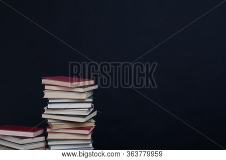 Lots Of Stacks Of Educational Books To Teach At The College Library On A Black Background