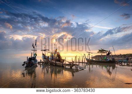 Beautiful Beach With Fisherman Boat During Sunrise On Fisherman Village.