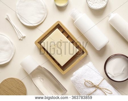 Care Products Lotion, Cotton Buds, Plant, Pads, Soap, Towel. Bath Accessories On Bright Background,