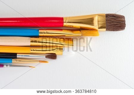 Art Paintbrushes Of Various Stroke Widths Isolated Against White