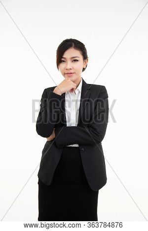 Thoughtful Young Asian Businesswoman Resting Her Chin On Her Hand And Looking Straight Into The Came