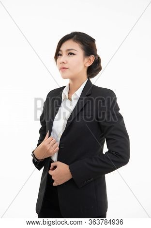 Closeup Portrait Of Cute Happy Asian Woman In Black Suit Looking Up Isolated On White Studio Wall Ba