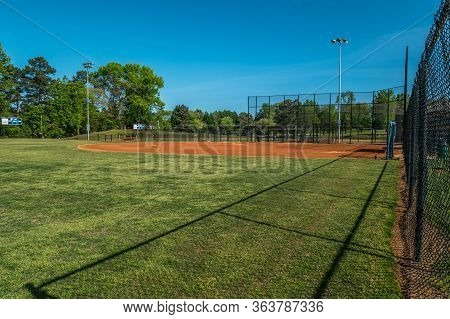 Empty And Vacant Baseball Fields Closed In The Springtime Due To The Coronavirus Pandemic Stay At Ho