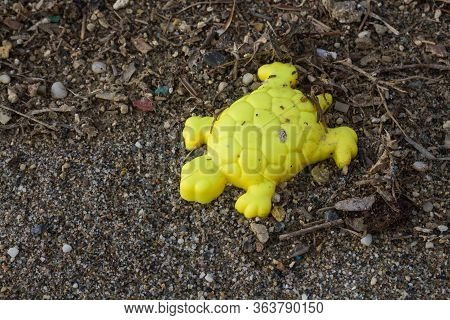 Yellow Turtle Mold  For Kids Forgotten Or Lost On The Beach Among The Various Trash. Part Of The Set