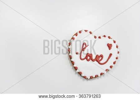 Closer Look At The Ginger Cookie With The Word Love. Selective Focus, Top View.