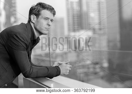 Young Handsome Businessman In Suit Looking At View Of The City