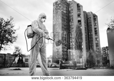 Sanitation Service Worker Disinfecting Public Space With Disinfectant Spray.street Disinfection.coro