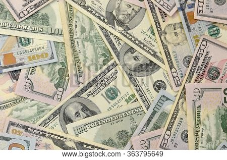 Many One Hundred And Fifty Dollar Bills On Flat Background Surface Close Up. Flat Lay Top View