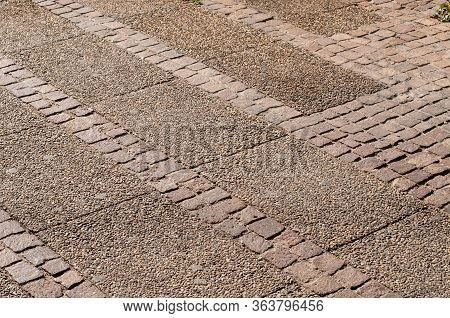 Pavement With Sett Stones And Blocks With Pebbles In Pedestrian Zone Of A City