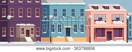 City Street With Urban Houses Under Snow Cover. Cold Winter Weather. Happy New Year And Merry Christ
