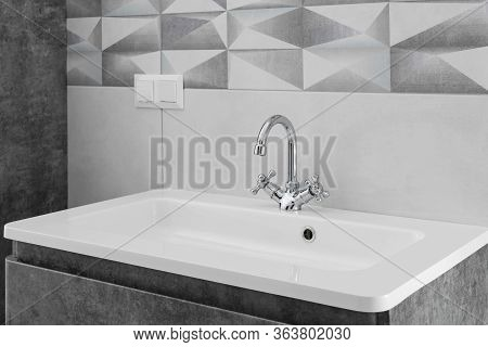 Modern Bathroom Metal Interior With Faucet And Ceramic White Sink.