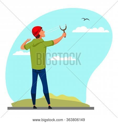 Naughty Teenager Boy Aiming With Slingshot At Bird Flying In Sky. Bad Guy With Catapult Toy Making T