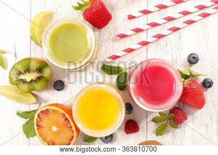 fruit juice, orange, berry fruit and kiwi smoothie