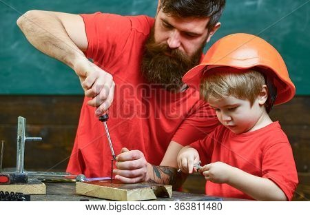 Father, Parent With Beard Teaching Little Son To Use Tool Screwdriver. Boy, Child Busy In Protective