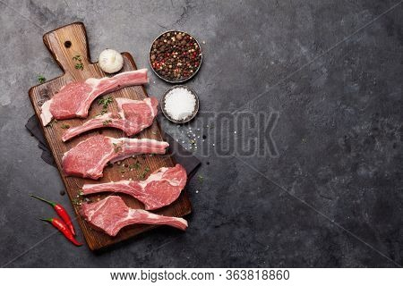 Lamb ribs cooking. Raw rack of lamb with spices and condiments. Top view with copy space