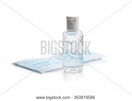 Coronavirus prevention hand sanitizer gel and protection face mask  isolated on white background.