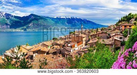 wonderful lake of Italy Lago di Garda. Beautiful panoramic view of  Limone sul Garda village and mountains