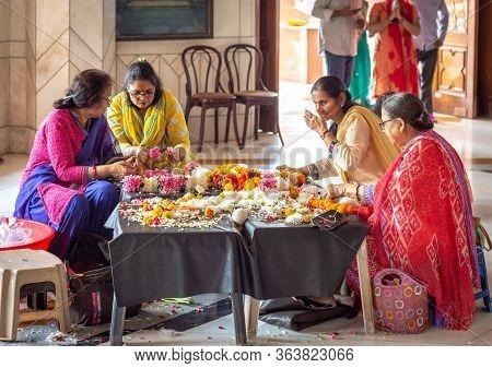 Hindu Women Weaving Flower Garlands At Iskcon Delhi Hindu Temple