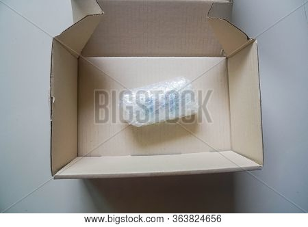 Top View Of Products Secured By Babble Sheet In Cardboard Carton For Shipping To Customers
