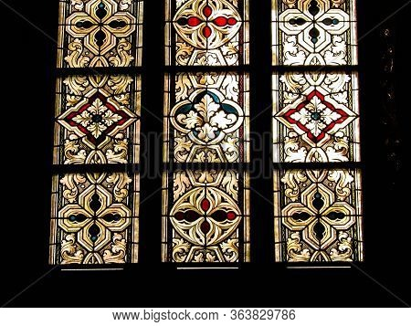 Stained Glass As Architecture Background. Arch-see In Frombork. Art Background. St. Andrew In Frombo