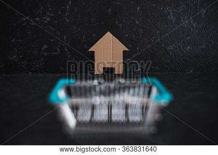 Real Estate Market And Buying A Property, House Icon Iand Shopping Basket Symbol Of Homebuyers