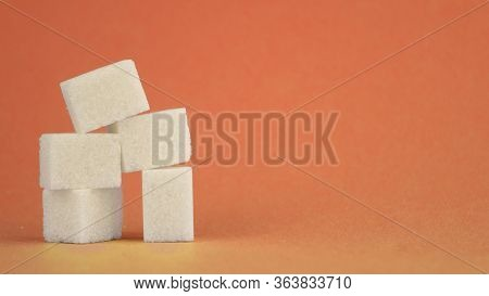 White Sugar Cubes Lie On A Red Background