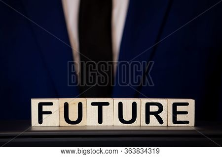 Close Up Hand Of A Businessman Arranging Small Wooden Blocks With Future Words On Blocks