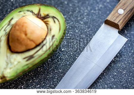 Half An Avocado Fruit And Kitchen Knife