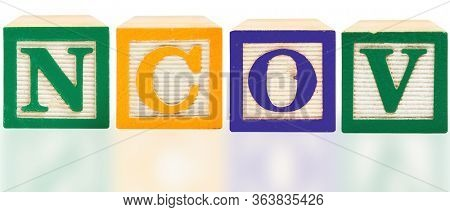 NCOV spelled  in bold color aphabet blocks over white in English