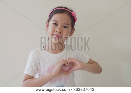 Mixed Asian Girl Making Heart Shape Hands, Generous, Love And Kindness, Sustainable Living, Donate,