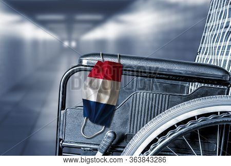 3d Rendering Of Flag Of France On Face Mask Hanging On Empty Wheelchair In Hallway Of French Hospita