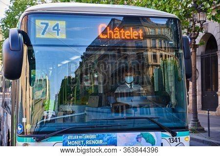 Paris , France - April 25 , 2020 : public bus driver wearing protcetion mask during the lock down coronavirus covid-19 quarantine