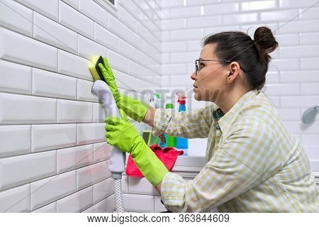 Woman Doing Bathroom Cleaning At Home, Female Washing Tile Wall With Steam. Using Steam Cleaner For