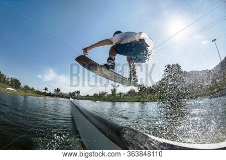 Ma Wakeboarder Jumps At Ramp At Wake Park