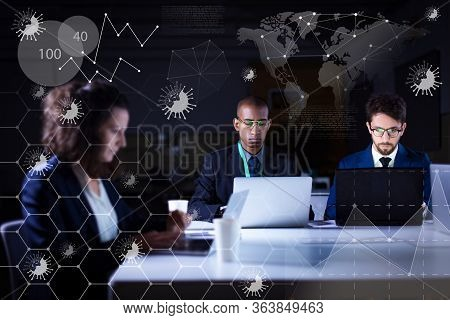 Focused Business Team Working At Night In Office. Concentrated Office Managers Analyzing Virtual Cor