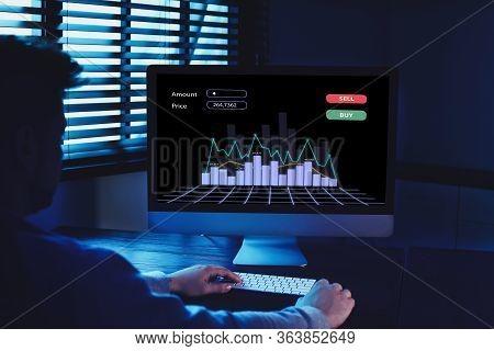 Broker Using Computer In Dark Room. Forex Trading