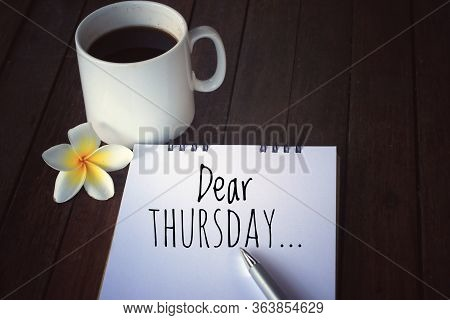 Dear Thursday Note Message On White Spiral Notebook. Thursday Plans And Hope Concept.  A White Cup O