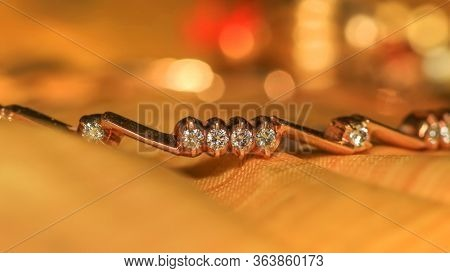 Modern  golden bangle with diamonds embedded