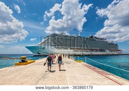 Cozumel, Mexico - April 24, 2019: Cruise Passengers Arrive To The Cruise Ship To Check In And Board