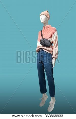 Full Length Female Mannequin Dressed In Pink Faux Fur Pullover, Isolated On Blue Background. No Bran