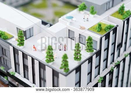 Miniature Model, Miniature Toy Buildings, Cars And People. City Maquette. New Building Project