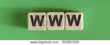 Www Text On Wooden Cubes On A Green Background