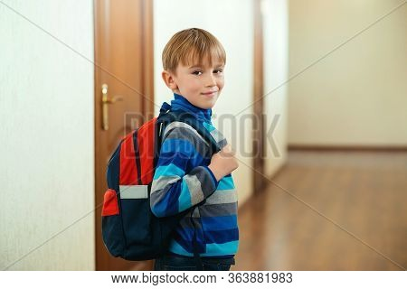 Happy Schoolboy With Backpack Going To Class. Back To School. Pupil Go To Study With Backpack.