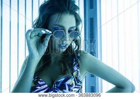 Portrait Of A Sexy Young Woman In Curly Hair In Sunglasses With A Stylish Manicure In A Trendy Chic