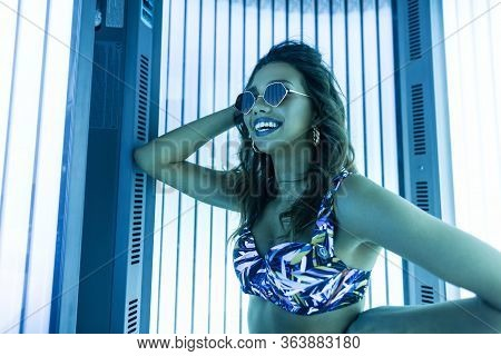 Funny Elegant Young Woman Hipster With Smile In Stylish Sunglasses In A Vintage Blue Swimsuit With C
