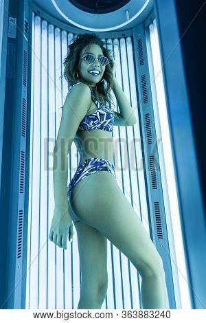 Fashionable Young Funny Woman Fashion Model In A Blue Swimsuit In Trendy Sunglasses With Happy Smile