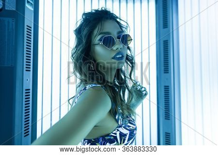 Modern Stylish Young Woman Hipster With A Fashionable Hairstyle In Vintage Sunglasses In A Glamorous