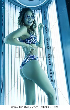 Modern Positive Young Hipster Woman In Sunglasses In A Fashionable Blue Swimsuit With A Beautiful  S